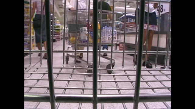 sped-up shots showing the view from a shopping trolley or cart as it is wheeled around, shoppers choosing from shelves filled with uniform products... - choosing stock videos & royalty-free footage