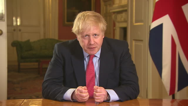 "vídeos de stock e filmes b-roll de speech boris johnson pm making announcement to place uk in lockdown to halt coronavirus ""from this evening i give the british people the simple... - plano picado"
