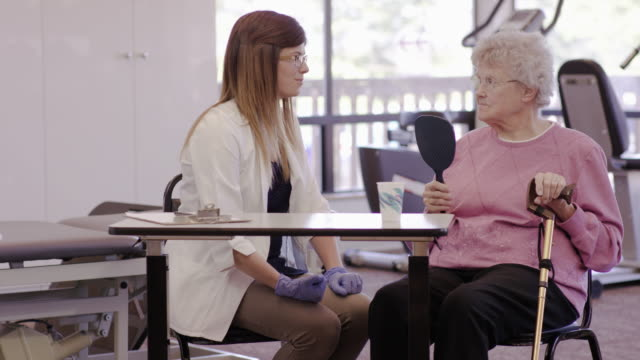 Speech therapist working with a geriatric patient in a clinic