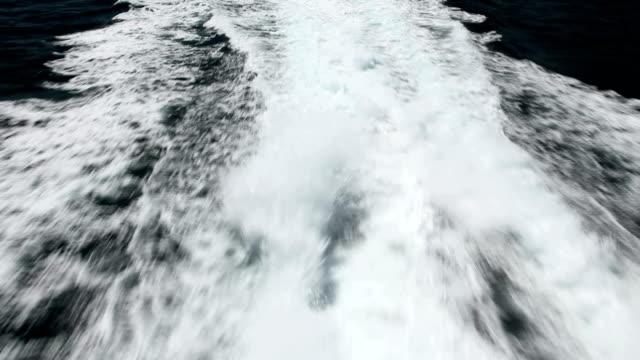 speed boat leaving island