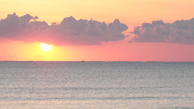 TS PAN speed boat moving along horizon at sunrise