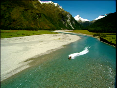 speed boat races along shallow river mount aspiring national park new zealand - national park stock videos & royalty-free footage