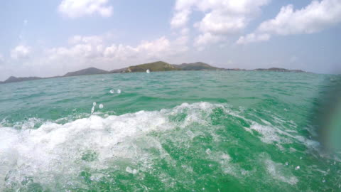 ws pov speed boat with water splashing on the camera - speed boat stock videos & royalty-free footage
