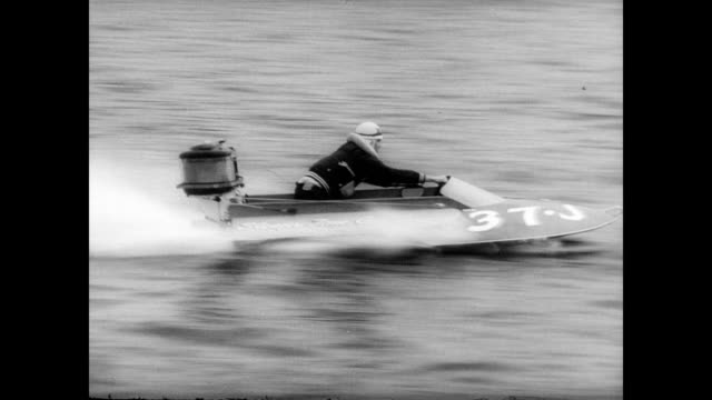 vídeos y material grabado en eventos de stock de / speed boats race across lake wampatuck / cu of individual boat drivers / boats flip on the turn / crowd watches from the river bank using... - hidroplano