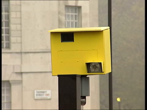 speed cameras removed in london itv late news emma murphy london ext cs speed camera pull out traffic along road ms yellow speed camera bv police car... - itv late news stock-videos und b-roll-filmmaterial