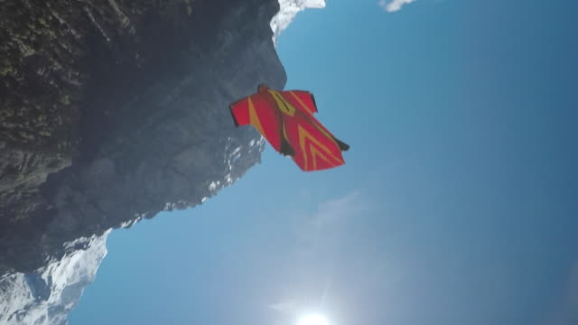 Speed drone following wingsuit flyer