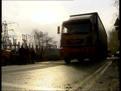 Builder prosecuted Blunkett attacked NEWS AT TEN ADRIAN Lorries rattling as they pass over sped hump