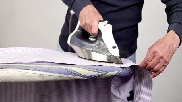speed ironing striped shirt time-lapse - ironing board stock videos & royalty-free footage