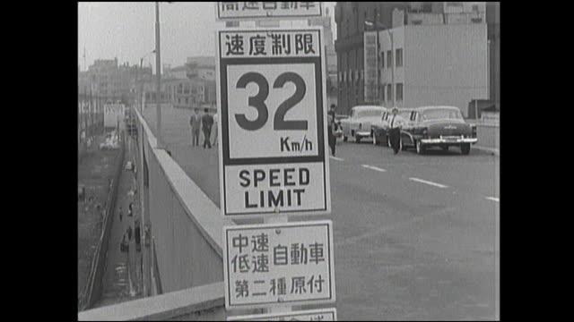 vídeos y material grabado en eventos de stock de speed limits and other signs line the new tokyo expressway. - señal de información