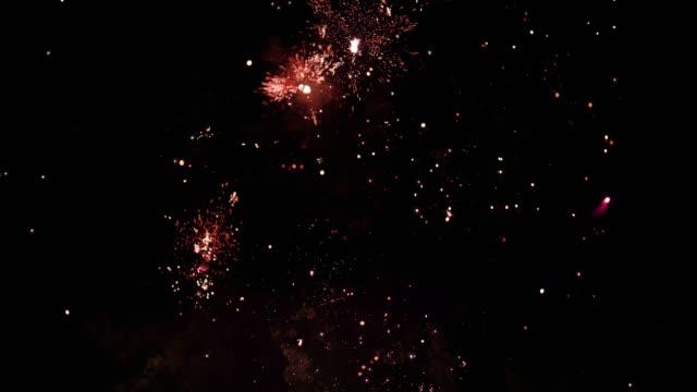 Speed ramp slomo of red firework display