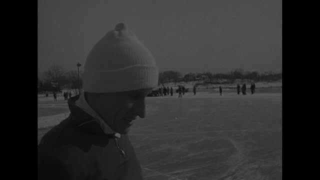 stockvideo's en b-roll-footage met ws speed skaters racing around course at powderhorn park crowd watching / shot of people in crowd / male speed skaters ready at starting line / cu... - st. paul minnesota
