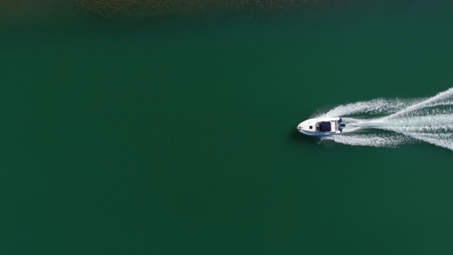 speedboat aerial view - cruising stock videos & royalty-free footage
