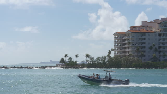 speedboat and apartment buildings in miami - speed boat stock videos & royalty-free footage