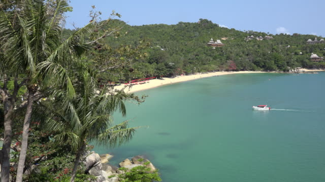 a speedboat arrives on a lonely bay - gulf of thailand stock videos & royalty-free footage
