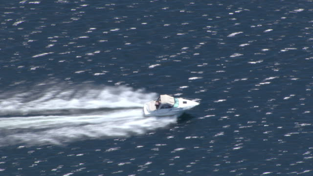 a speedboat glides over a lake. - speed boat stock videos & royalty-free footage