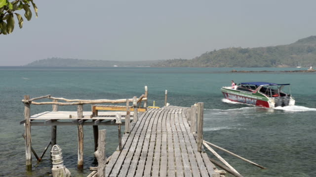 a speedboat leaves wooden jetty - gulf of thailand stock videos & royalty-free footage