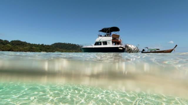 speedboat moored on perfect shallow sea lagoon split level shot koh rok - ross sea stock videos & royalty-free footage
