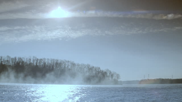 a speedboat travels on a foggy river. - 1990 stock videos & royalty-free footage