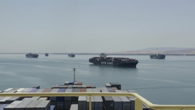 speeded up shots from the deck of the ebba maersk container ship, operated by a.p. moeller-maersk a/s, in the great bitter lake during its southbound... - suez canal stock videos & royalty-free footage