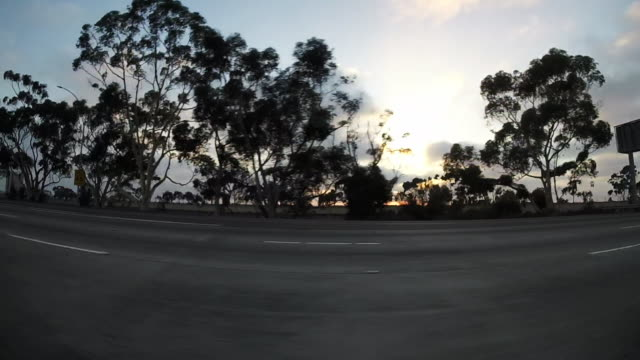 Speeding down California highway, sunset