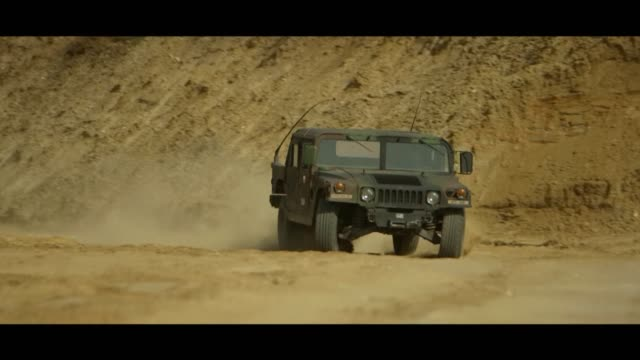 speeding military hummer in desert - matte image technique stock videos & royalty-free footage