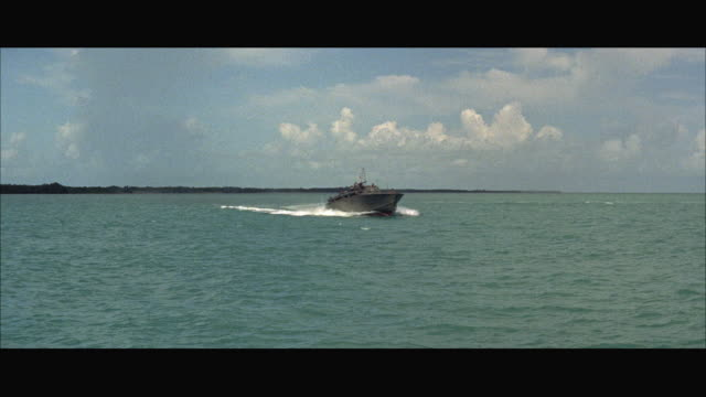 stockvideo's en b-roll-footage met ws pan speeding p-t boat in sea - amerikaanse zeemacht