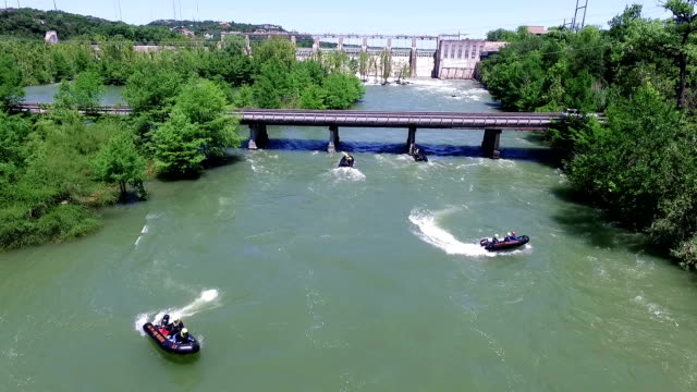 speeding rescue boats make risky u turn during flood practice - rescue worker stock videos & royalty-free footage