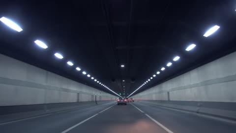 vidéos et rushes de speeding through tunnel - droit