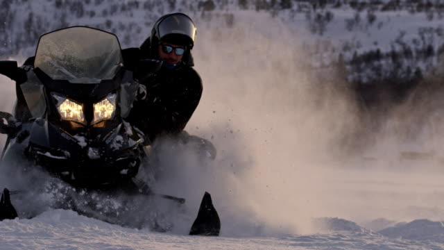 slo mo speeding with a snowmobile - sunny stock videos & royalty-free footage