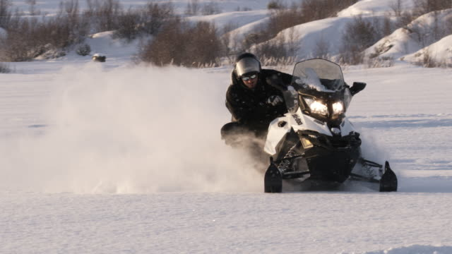 slo mo speeding with a snowmobile - sledge stock videos & royalty-free footage