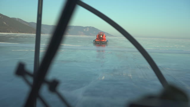 speedy hovercraft travels on frozen lake baikal seen through vehicle - hovercraft stock videos & royalty-free footage