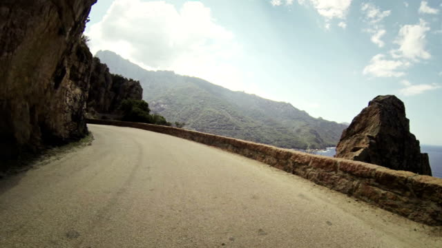 speedy rally car onboard camera on road in corsica - curve stock videos and b-roll footage