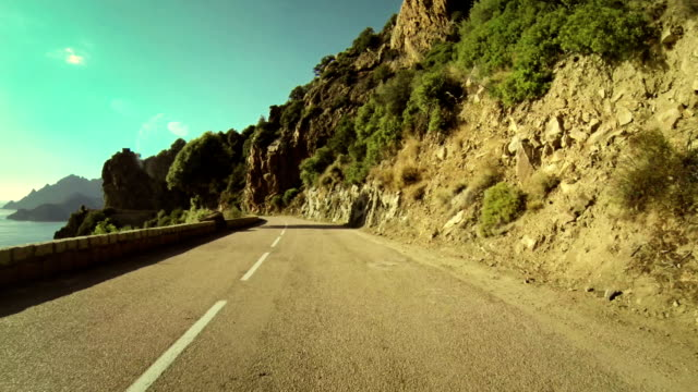 speedy rally car onboard camera on road in corsica - motorbike stock videos & royalty-free footage