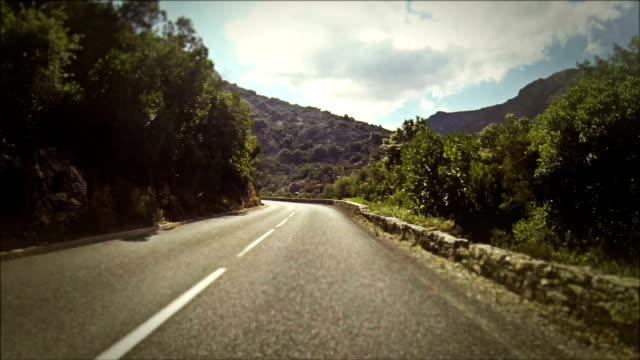 speedy rally car onboard camera on road in corsica - mountain road stock videos & royalty-free footage