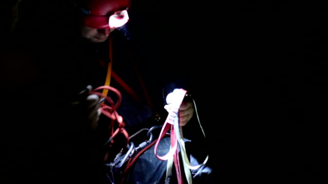 speleology explorer in a cave preparing equipment - krab stock videos & royalty-free footage