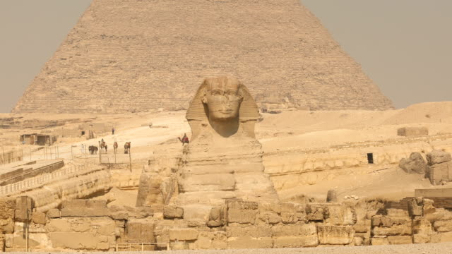 sphinx and great pyramids at giza, cairo, egypt - north africa stock videos & royalty-free footage