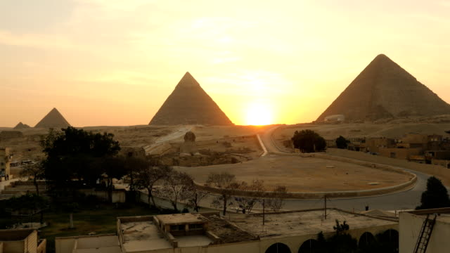 sphinx and great pyramids at giza, cairo, egypt - pyramid stock videos and b-roll footage