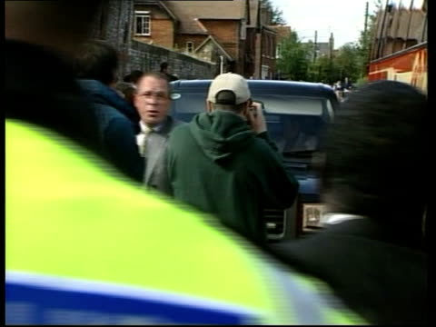 ITN ENGLAND Bucks Little Marlow Line of security men along to church Crowds surrounding 4wheeldrive vehicle of guest as along Security man...