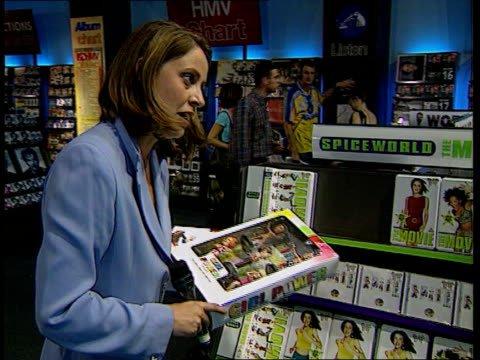 vídeos de stock e filmes b-roll de london int spice girls merchandise piled on table i/c gennaro castaldo intvw how geri's departure will affect sales displays tilt down spice world... - spice girls