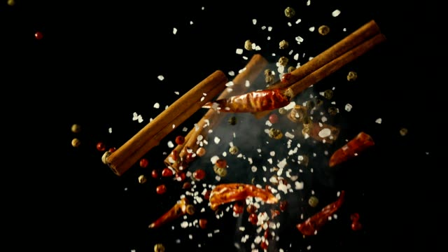 spice mix food explosion with chili and peppercorns - still life stock videos and b-roll footage