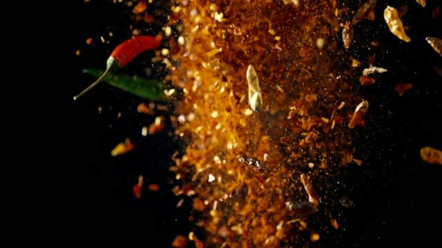 spice mix food explosion with chili and peppercorns - peperone video stock e b–roll