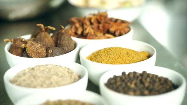 spices and herbs on kitchen table. dolly shot - thai food stock videos and b-roll footage