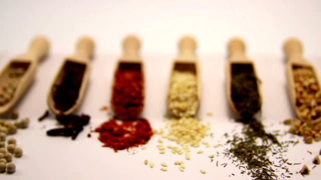 spices. spice in wooden spoon. herbs, saffron, cinnamon and other isolated on a white background - spoon stock videos & royalty-free footage