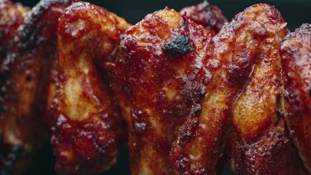 spicy chili chicken wings roasting on s spit - grilled chicken stock videos and b-roll footage