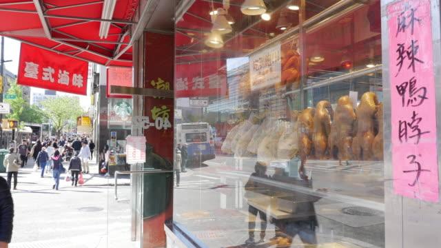 vídeos y material grabado en eventos de stock de spicy duck neck (chinese script), meat store in flushing, queens, new york - flushing