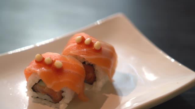 spicy salmon maki - toro fish stock videos and b-roll footage