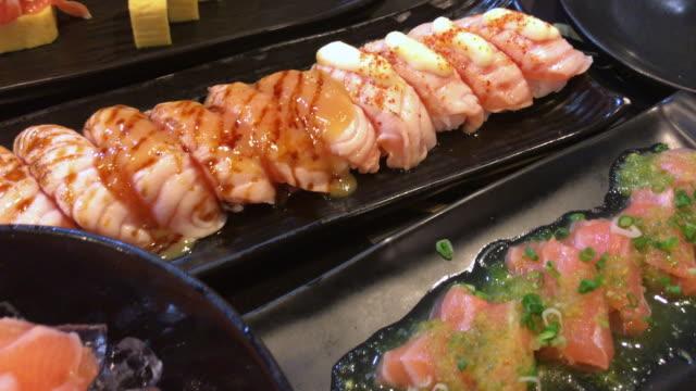 spicy salmon salad and sashimi on dining table , bangkok , thailand. - salmon salad stock videos & royalty-free footage