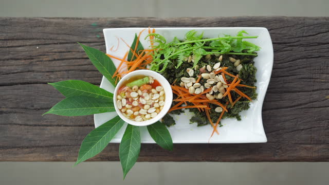 spicy vegetable salad thai food on plate slow motion - fern stock videos & royalty-free footage