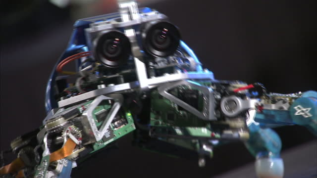 A spider-like robot moves up and down on many legs.