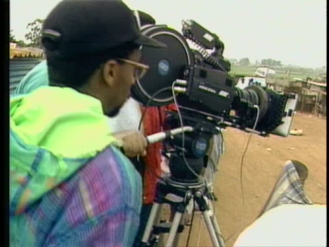 mcu spike directing by camera cu clapboard with malcolm x on it zoom out end of camera lens to spike directing cu spike in malcolm x cap - end cap stock videos & royalty-free footage